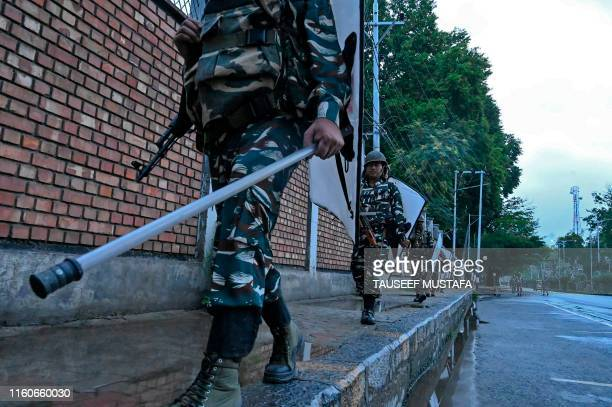 Security personnel patrol during a lockdown in Srinagar on August 10 2019