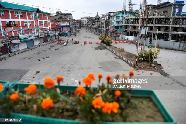 Security personnel patrol on a deserted road during a lockdown in Srinagar on August 15 as India celebrates its 73rd Independence Day.