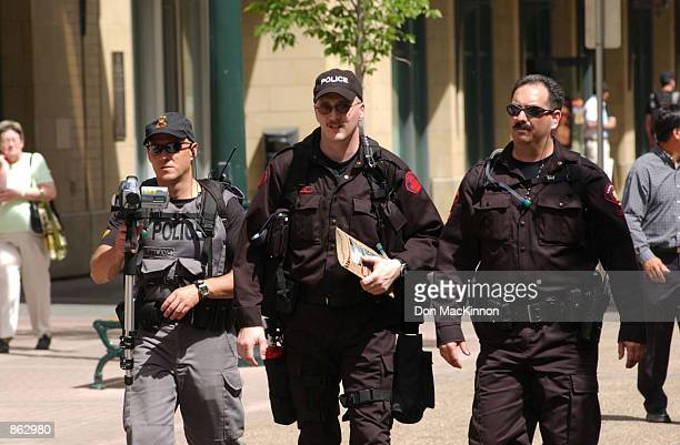 Security personnel patrol the area during the first day of the G8 summit as security is increased for the meeting June 25 2002 in dowtown Calgary...