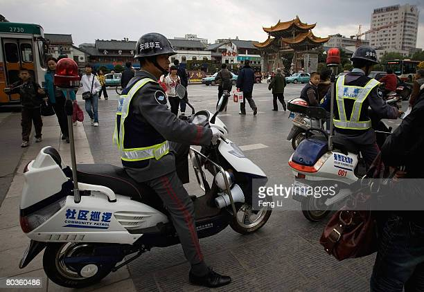 Security personnel patrol the streets of Kunming by mopeds on March 23 2008 in Yunnan Province China