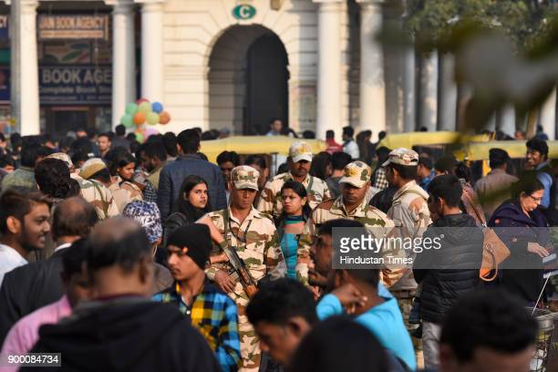 Security personnel patrolling on the eve of New Year at Connaught Place on December 31 2017 in New Delhi India People of Delhi throng to the markets...