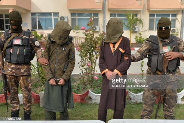 Security personnel present to the media two suicide attackers , who according to officials were arrested before detonating explosives, in Jalalabad...