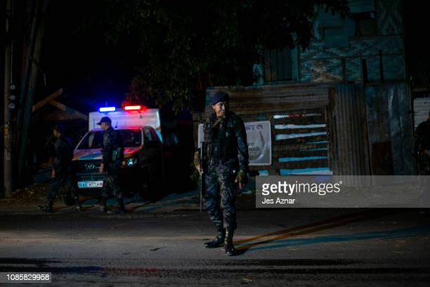 Security personnel secure a checkpoint on the eve of the plebiscite on January 20 2019 in Cotabato City southern Philippines Nearly three million...