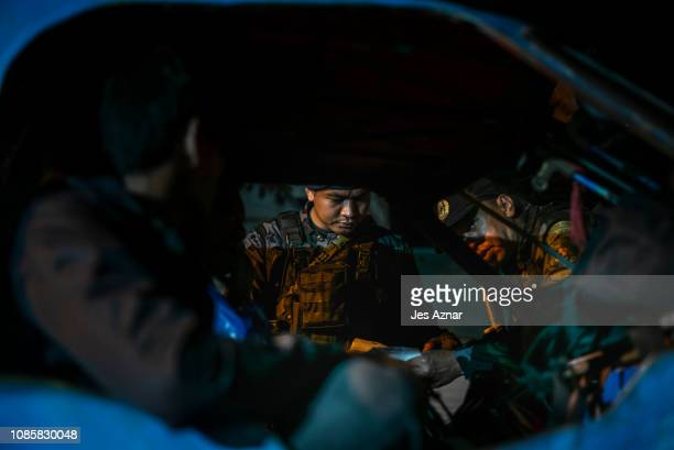 Security personnel secure a checkpoint on the eve of the plebiscite, on January 20, 2019 in Cotabato City, southern Philippines. Nearly three million...
