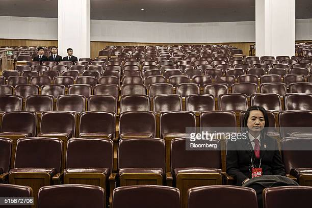 Security personnel sit in an auditorium inside the Great Hall of the People on the closing day of the 12th National People's Congress in Beijing...