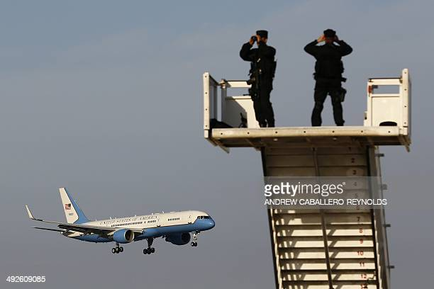 Security personnel stand guard as US Vice President Joe Biden's plane approaches Larnaca airport on May 21 2014 in the Cypriot southern port city...