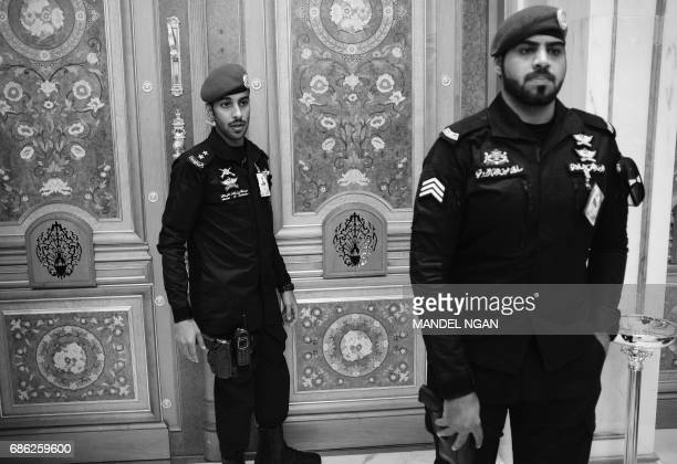 Security personnel stand guard at a door inside the before the USGCC Summit at the King Abdulaziz Conference Center in Riyadh on May 21 2017 / AFP...