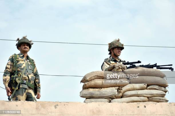 Security personnel stand guard at a post near AttariWagah border on March 1 2019 some 35 Kms from Amritsar India Wing Commander Abhinandan Varthaman...