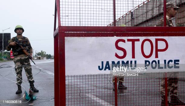 Security personnel stand guard at a roadblock in Jammu on August 7 2019 A protester died after being chased by police during a curfew in Kashmir's...