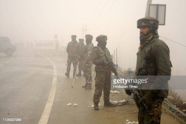 Security personnel stand guard at the blast site in Lethpora area of south Kashmir's Pulwama district some 25 kilometers south of Srinagar on...