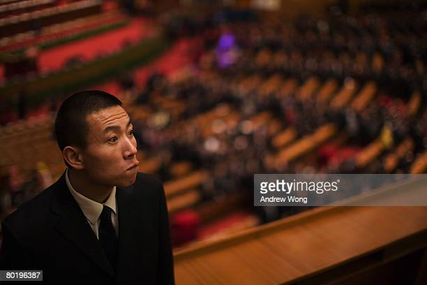 Security personnel stand guard at the end of the fourth plenary session of the National People's Congress or parliament at the Great Hall of the...