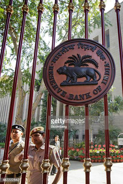 Security personnel stand guard behind a gate at the Reserve Bank of India headquarters in New Delhi India on Sunday March 22 2015 Jaitley said he...