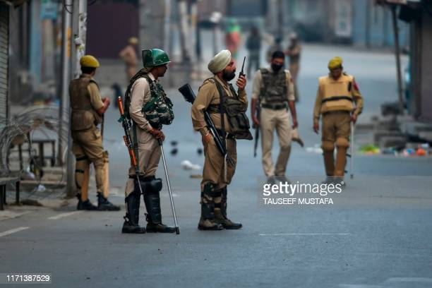 Security personnel stand guard during a lockdown at Maisuma locality of Srinagar on September 27 2019