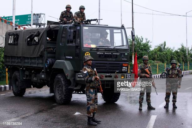 Security personnel stand guard on a street in Jammu on August 5 2019 Authorities in Indianadministered Kashmir placed large parts of the disputed...