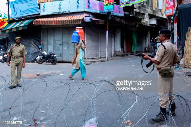 Security personnel stand guard on a street in Jammu on August 6 2019 Washington on August 4 urged respect for rights and called for the maintenance...