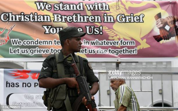 Security personnel stand guard outside a mosque during Friday noon prayer in Colombo on May 3 following a series of bomb blasts targeting churches...
