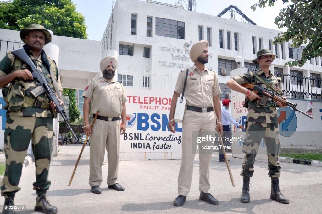 Security personnel stand guard outside BSNL Office Ranjeet Avenue on August 28 2017 in Amritsar India Selfstyled godman Gurmeet Ram Rahim Singh was...