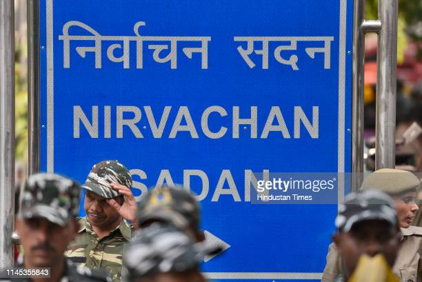 Security personnel stand guard outside Election Commission of India as 21 opposition party leaders arrive to meet the Election Commission at...