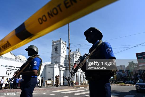 TOPSHOT Security personnel stand guard outside St Anthony's Shrine in Colombo on April 22 a day after the church was hit in a series of bomb blasts...