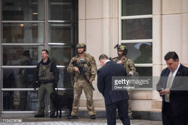 Security personnel stand guard outside the US District Court for the Eastern District of New York after a guilty verdict was reached in the El Chapo...