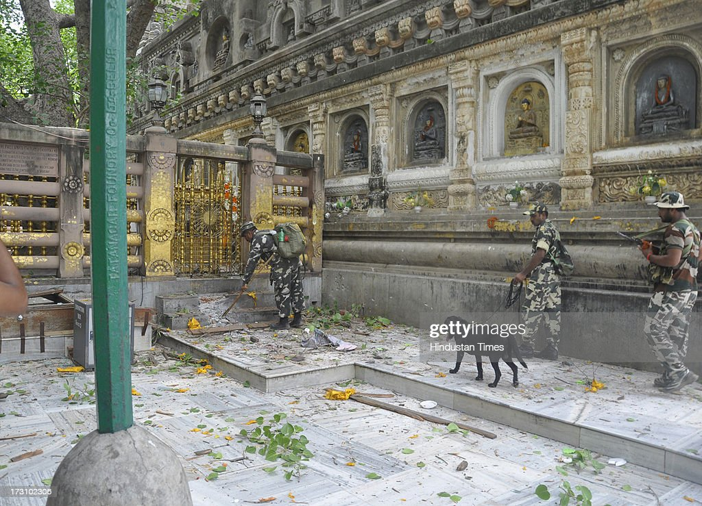 Security personnel stand guard the campus of Mahabodhi Temple after the series of blast at Bodhgaya on July 7, 2013 in Bihar, India. Nine serial explosions today rocked the internationally renowned temple town of Bodhgaya. Two people have been injured in a series of blasts inside the Mahabodhi temple in Bihar's Bodhgaya district.
