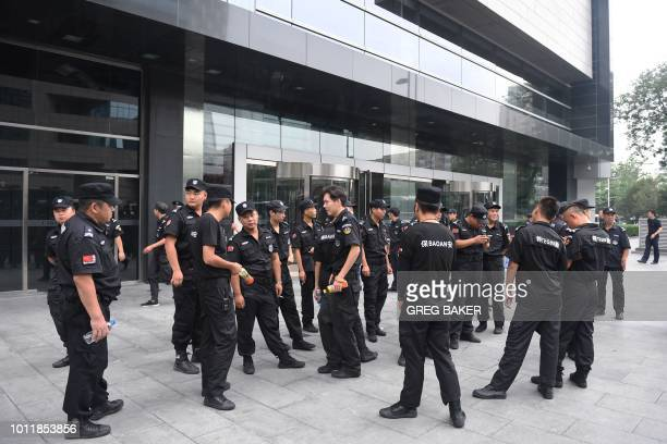 Security personnel stand in front an entrance of China's Banking Regulatory Commission in Beijing on August 6 2018 Hundreds of police swarmed the...