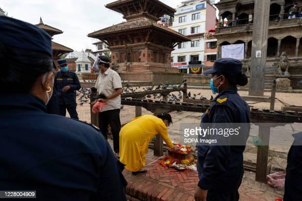 Security personnel stand on guard while wearing face masks during the festival at Hanuman Dhoka Sadak near Kathmandu Durbar Square Krishna...
