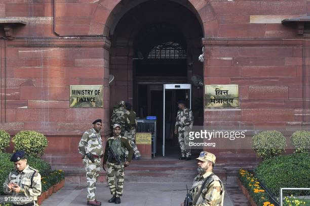 Security personnel stand outside an entrance to the North Block of the Central Secretariat building before India's finance minister Arun Jaitley...