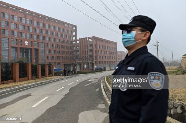 Security personnel stands guard as members of the World Health Organization team investigating the origins of the COVID-19 coronavirus, make a visit...