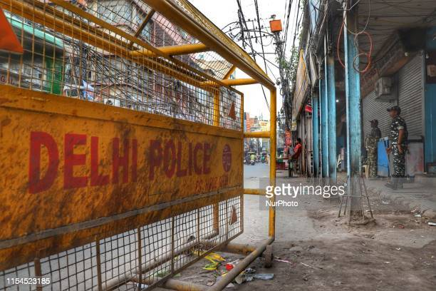 Security personnel stands guard near Chawri Bazaar in Old Delhi India on 7 July 2019
