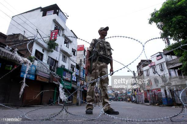 TOPSHOT A security personnel stands guard on a street in Jammu on August 6 2019 Washington on August 4 urged respect for rights and called for the...