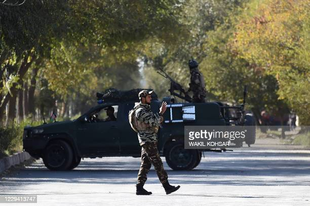 Security personnel stands guard outside the Kabul University in Kabul on November 2, 2020. - Gunmen stormed Kabul university on November 2 ahead of...