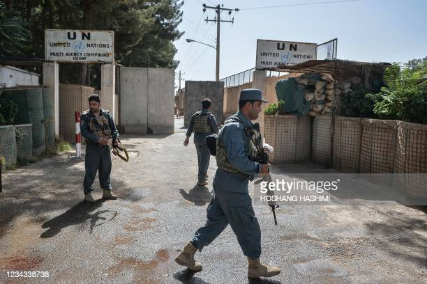 Security personnel stands guard outside United Nations Assistance Mission in Afghanistan office compound in Guzara district of Herat province on July...