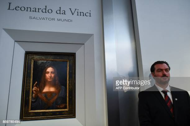 A security personnel stands next to Leonardo da Vinci's Salvator Mundi after it was unveiled at Christie's in New York on October 10 2017 One of...