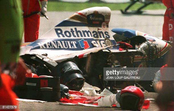 Security personnel surround the crashed car of Brazilian Formula One driver Ayrton Senna at the Imola track 01 May 1994 The triple F1 crashed at the...