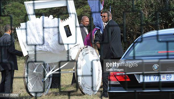 Security personnel surround the rickshaw used to transport the bride and her father during the wedding celebrations for President Jacob Zuma's...