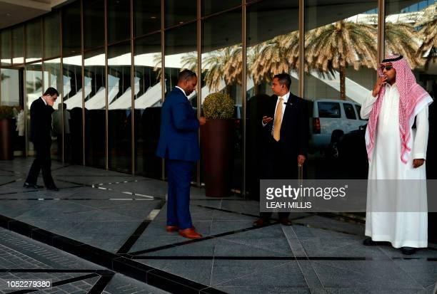 Security personnel take a smoke break while waiting between meetings between US Secretary of State Mike Pompeo and Saudi Crown Prince Mohammed bin...