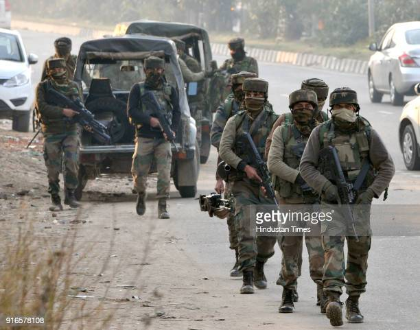 Security personnel take position during an encounter with terrorists at Sunjuwan Military station on February 10 2018 in Jammu India Militants...