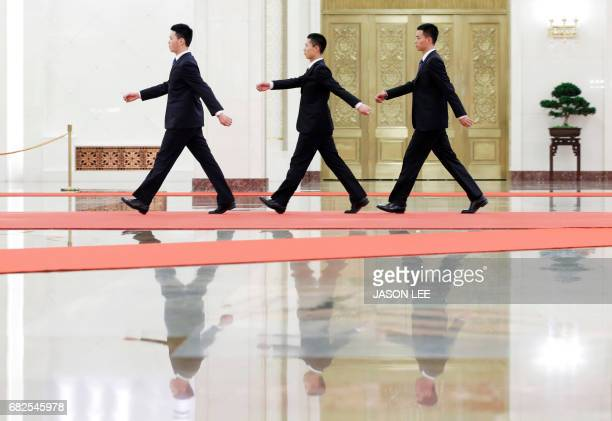 Security personnel walk inside the Great Hall of the People before the meeting between Malaysian Prime Minister Najib Razak and Chinese President Xi...