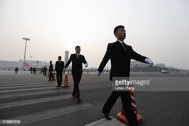 Security personnel walks prior outside the Great Hall of the People during the closing session of the National People's Congress on March 16 2016 in...
