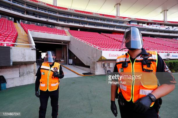 Security personnel wear masks as part of the COVID 19 protocol prior to the match between Mazatlan FC and Tigres UANL as part of friendly torunament...