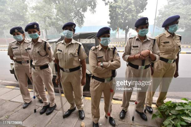 Security personnel wear masks as they stand guard during a hazy morning, on November 3, 2019 in New Delhi, India. The air quality index hit 473 at 9...