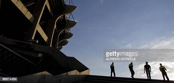 Security personnel wear masks at the Azteca Stadium in Mexico City on May 9 before the Mexican league football match America vs Necaxa AFP...