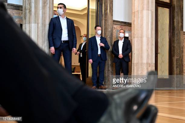 Security personnel wearing protective masks attend a joint press conference of Hungarian Prime Minister and Serbian President in Belgrade on May 15,...