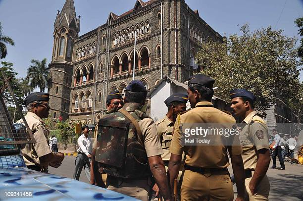 Security persons stand guard at Bombay High Court during a hearing for the verdict on Ajmal Kasab's death sentence in Mumbai on Monday The court...