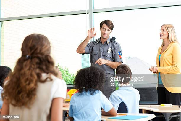 Security professional talks with group of school children