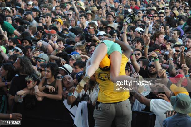 Security pulls a girl out of the crowd at the Death From Above 1979 show during Day 3 of the Coachella Valley Music Arts Festival 2011 held at the...