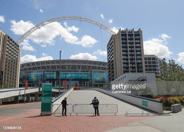 Security put barriers up outside Wembley stadium on what should have been FA Cup Final day on May 23 2020 in London England The British government...