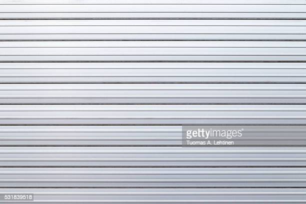 Security roller door background - corrugated metal sheet.