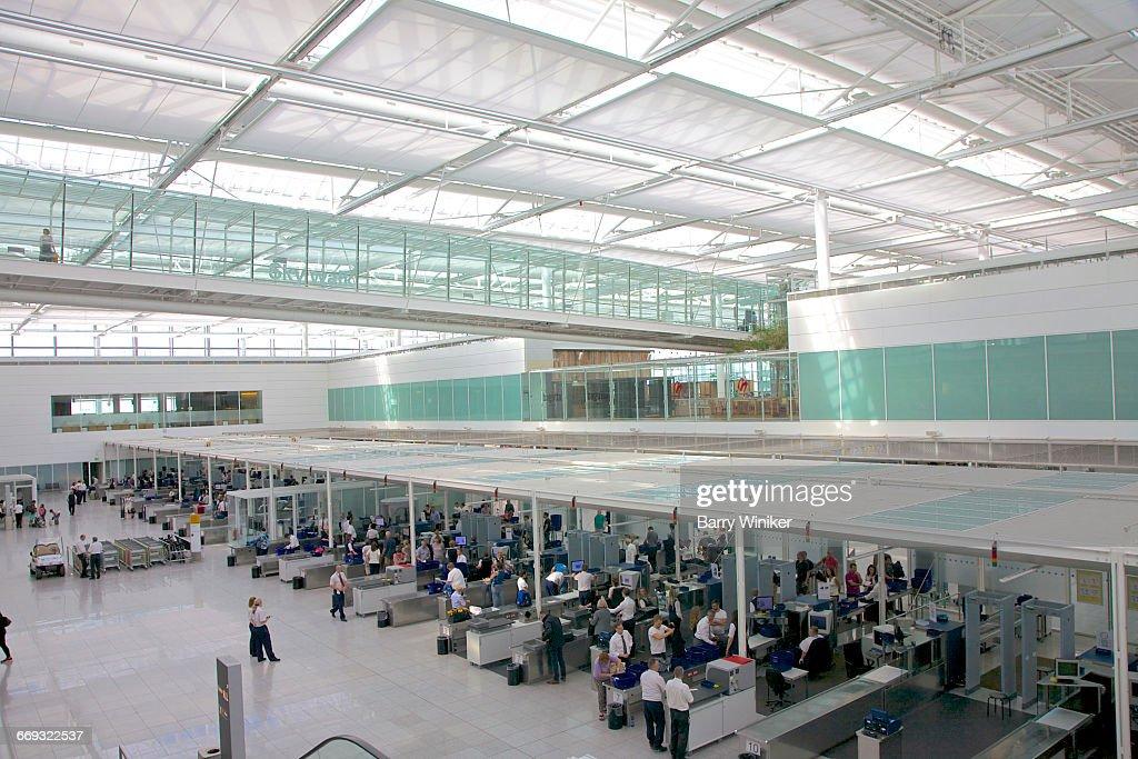 Security screening, airport terminal, Munich : Stock Photo